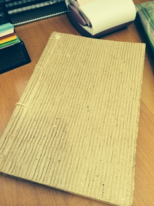 Old notebook made of recycled paper with corrugated cover