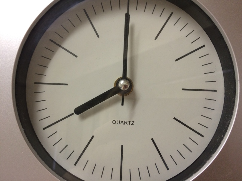 Plain clock face showing 8:00.
